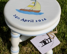 Milking stool with sailing boat
